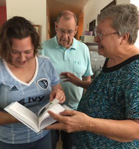 Clients give their daughter a personal history book of their life